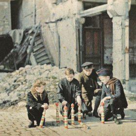 Enfants jouant aux quilles dans les ruines de Reims (place d'Erlon) Autochrome by Fernand Cuville, 6th March 1917